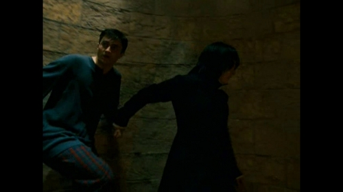 "As much as the inner Snarry in me wishes it were true, Severus isn't holding Harry's hand: he's pulling him down the stairs द्वारा his wrist. I think pulling him down the stairs was necessary. Dumbledore कहा that the situation was urgent, then it ""couldn't wait, not even until morning."" They needed to get down to the dungeons as quickly as possible. Also, Harry isn't exactly doing all he can to get down into the dungeon -- he's fighting Severus the whole way. If Severus were to just let him go, Harry would stop and demand answers."