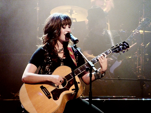 Demi on stage with a guitar :)