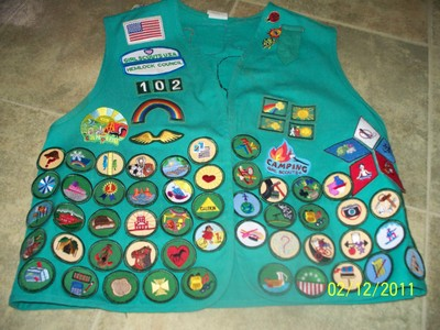 I've been a girl scout for 9 years. this is one of my old vests. my Junior vest to b exact: