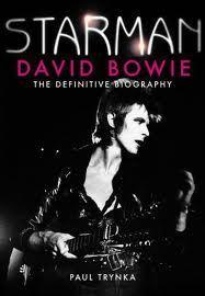 "a David Bowie biography named ""Starman"" and an अलादीन Sane t-shirt"