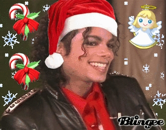 Michael Jackson wearing a santa hat* I put the hat on him* its so cute ^_^