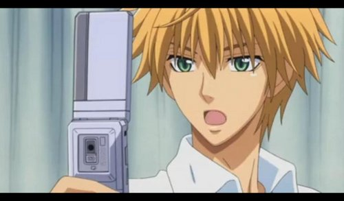 Usui with a cellphone :)