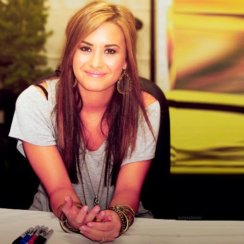 Demi Lovato Sitting & Wearing Big Earrings =]]
