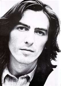 It says that I Liebe George Harrison!