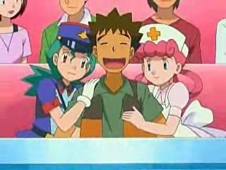 brock, the girl crazed breeder from pokemon :D yay for brock, he finally gets his beloved girls!!! XD (ps hes the one in the middle)