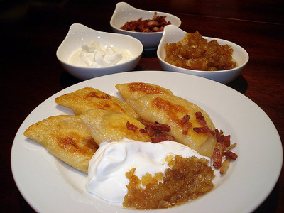 Perogies! with sauer, saure cream, speck bits and zwiebel perogies are just pastry filled with mashed potato