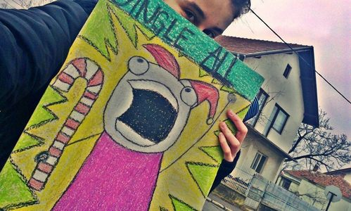 "My friend holding a picture that says: ""Jingle [u]ALL~[/u] the way!"" that I made her for Natale ^^"