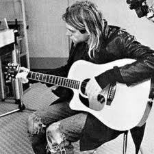 I want to learn how to play the guitar. as well as Kurt Cobain did.(: But That would never happen. (: