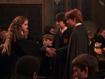 after huggin harry,she turned to ron and they were about to hug of confused what to do..finally they end up shaking hands together..thats the cutest moment..