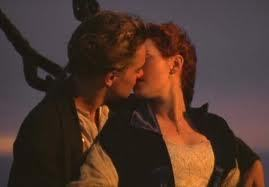 """On the bow of titanic while the sun was going down/""""last time titanic ever saw daylight""""/tail end of 1st part of movie"""