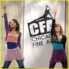 I'd say layering, yes. Colorfulness, and especially animal print. She also wears zany prints and shirts with lips on them. Here's her dance practice outfit, posing with Zendaya.