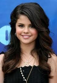 Selena is really pretty and in this picture it really captures it. It might be small but she's still really pretty in it.