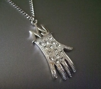 "The last MJ items I bought was a necklace, like the one on the pic, and Frank Cascio's book ""My Friend Michael""."