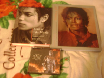 "Well, to tell あなた the honest truth I bought 3 pieces last 月 in February which are ""Michael Jackson's:Making of Thriller"" book によって Douglas Kirkland, HIStory CD, & ""Man in the Music: The Creative Life & Work of Michael Jackson"" によって Joseph Vogel just a few days apart from each other... However, it doesn't stop me from getting もっと見る pieces for my collection, because I will be getting もっと見る soon :) ♥"