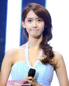 Deer Yoona holding a microphone