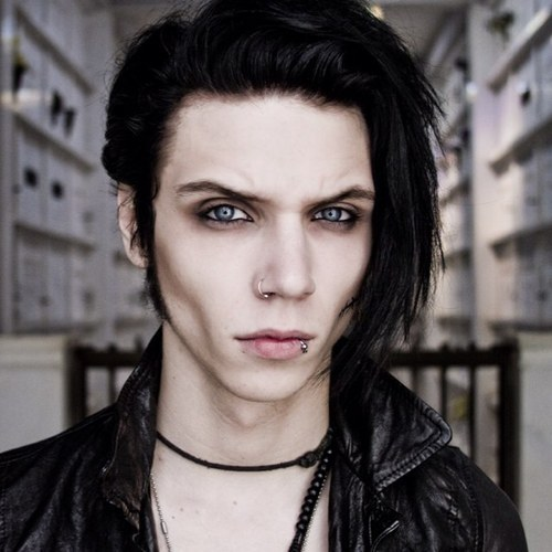 Andy has Bright Blue eyes and doesn't wear contacts.