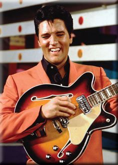 What a lovely idea! There isn't Elvis in orange yet, so here it is. Orange jacket and orangey colour guitar too!