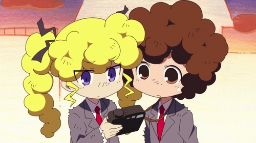 THey got afros after an explosion!XD It's from Kill me Baby
