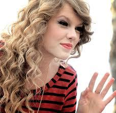 taylor dosen't really smile allot and that is what i love about her she is mystyrious