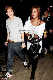 Yes, he is dating Demi Lovato. :(