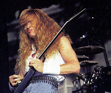 My absolute favorite band is Megadeth, and my favorite singer (and legendary guitarist) is Dave Mustaine - from Megadeth.<3