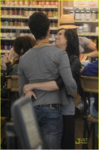 i think this is the cutest moment she looks so happy so u can see the pic better. http://www.justjaredjr.com/photo-gallery/365061/joe-jonas-demi-lovato-giggly-grocery-20/