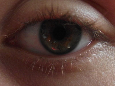 My eyes are green with brown centers ^-^ (see picture) and my hair is dirty Blonde. (which explains a lot x)