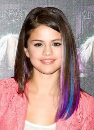 This is a picture of Selena with 3 different hair colors... pink, purple, and blue!