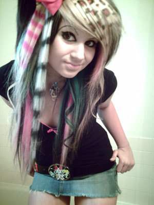 Christina Has Scene Hair. She doesn't Dye it pink or purple or put in those bows in her hair like so