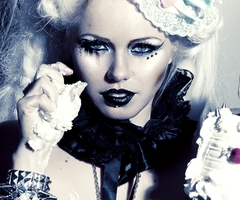 "Ive become obsessed with ""Kerli"" because of ""Tea Party"" on the ""Almost Alice"" CD. Is anyone else in this situation?"