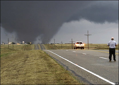 if te see a tornado what would te do either? take out te camera and take foto of the storm o get in safety?