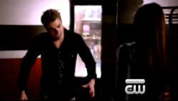 Stefan and Elena/him coming at her in the school.