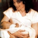 Michael holding Little Wendy (I know its him holding Prince, but pretend it's Wendy he's holding)