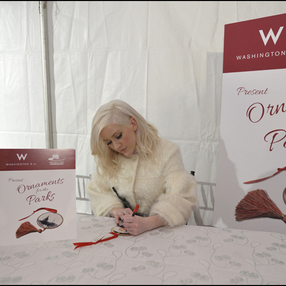 Ellie Goulding signing her ornament to benefit the National Park Foundation. Photo by Mark Silva for W Washington D.C.