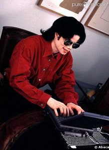 Michael at his computer and on twitter