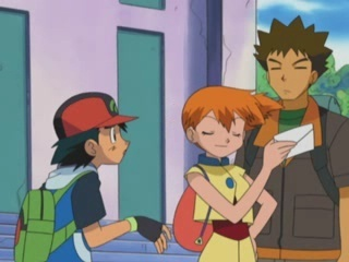 Misty grabs the Togepi festival invitation from Ash who is excited