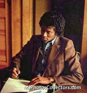 Michael at his desk writing a song