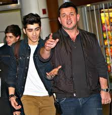 Zayn,quit trying to hold his hand. Paul says you can only hold my hand