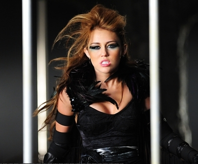 ROUND 3 Miley in her Can't be tamed video. I'm gonna stop this round when I get 8 replies. :)