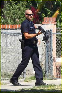 thts holding camera on the set of end of watch next:jake with talking on mobile oder phone!