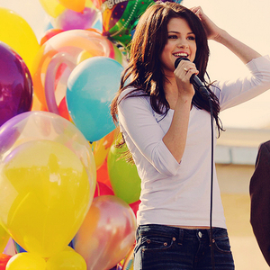 Selena holding a microphone :)