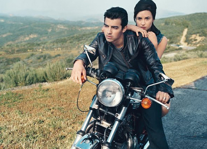 demi siiting on bike with Joe <3