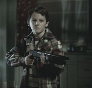 """Young Dean with a shotgun."""