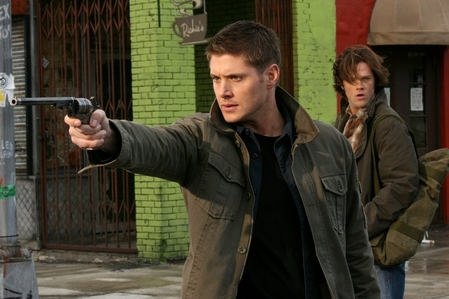 """Dean Winchester holding the Colt"""