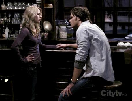 Sam holding Jo's hand...