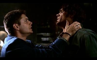 Dean holding Sam's collar...