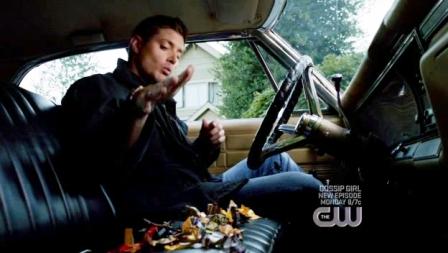 Dean eating kendi in the Impala...