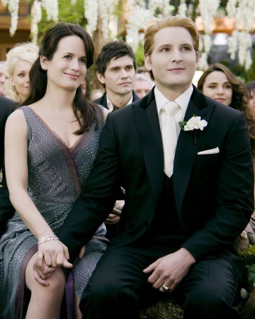 hot  Carlisle and Esme holding their hands in the wedding