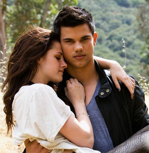 Hot!  Taylor holding Kristen in his arms.