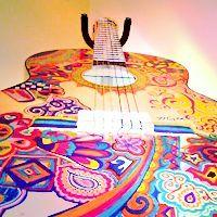 AC#5 [url=http://www.designflavr.com/resources/Gorgeous-Guitar-Art-and-Decoration-i111/]Source[/url]